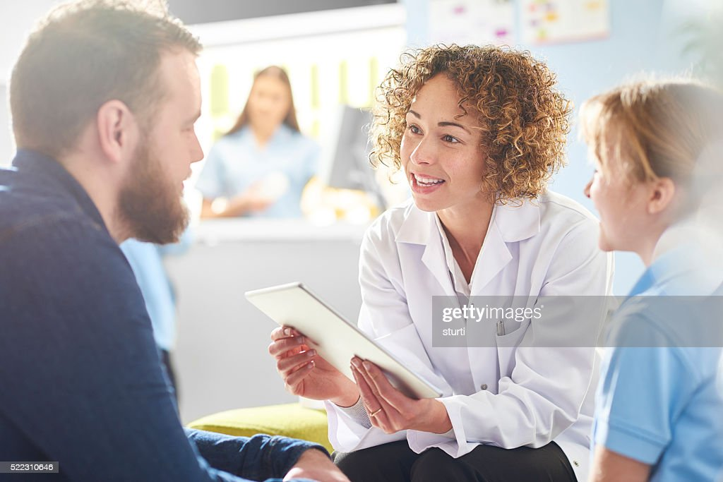 father and daughter chatting to pharmacist : Stock Photo