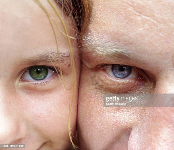 Father and daughter (6-8) cheek to cheek, portrait, close-up