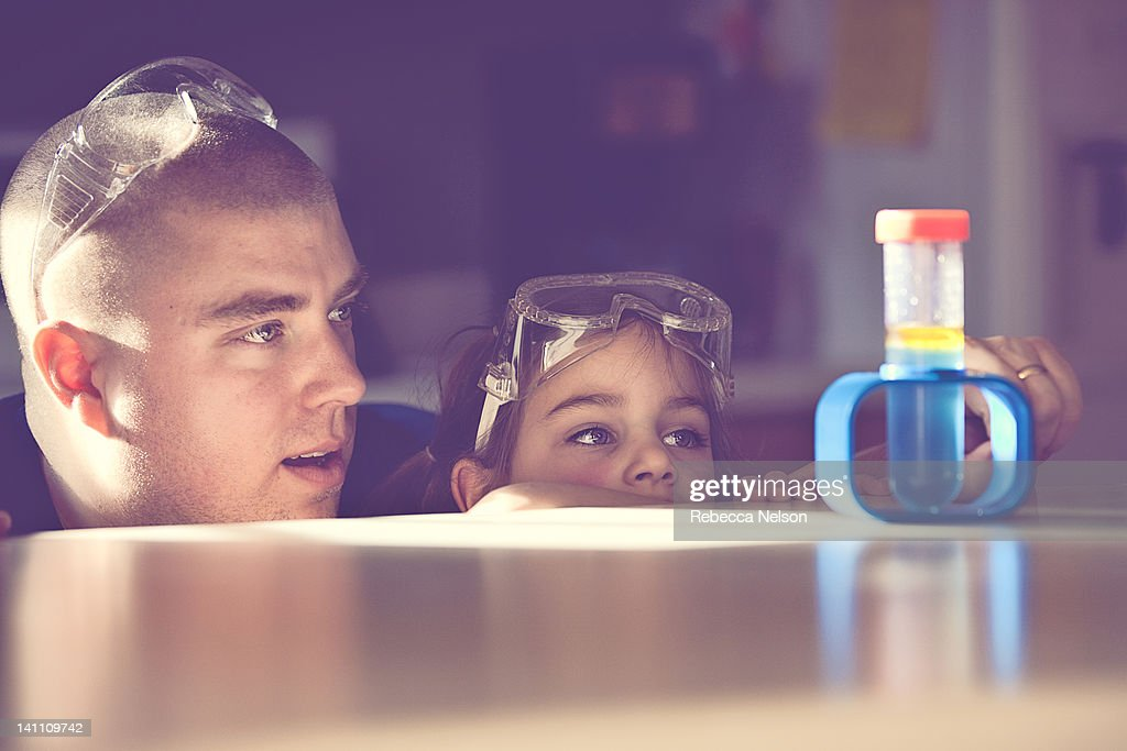 Father and daughter conducting science experiment : Stock Photo