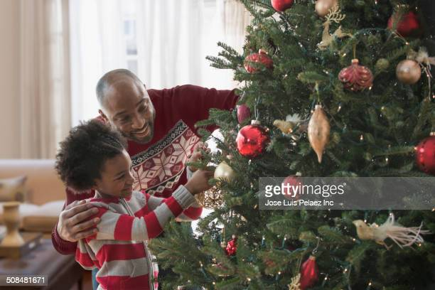 Black People Decorating For Christmas black people christmas stock photos and pictures | getty images