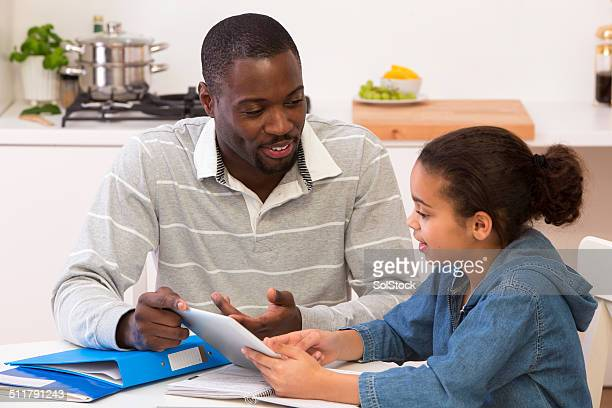 Father and Daughter Doing Homework