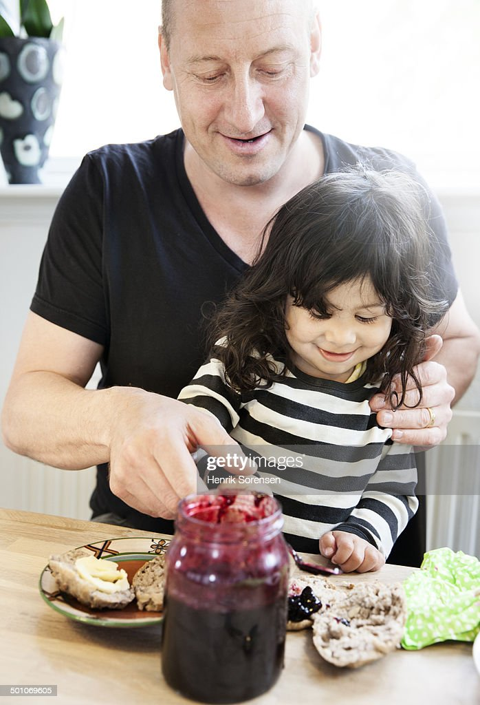 Father and daughter eating breakfast
