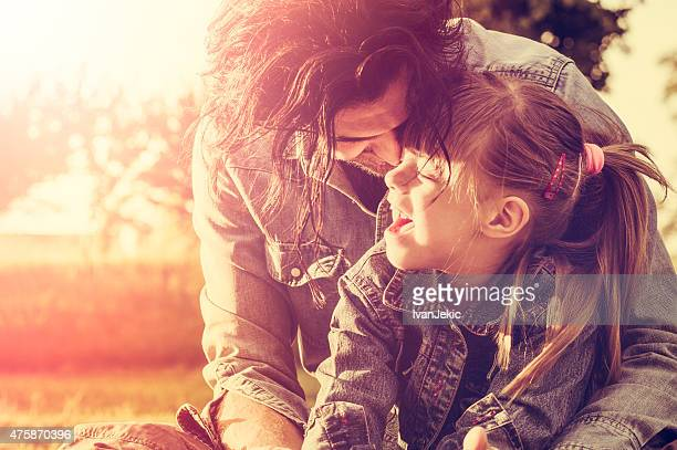 Father and daughter embracing at sunset