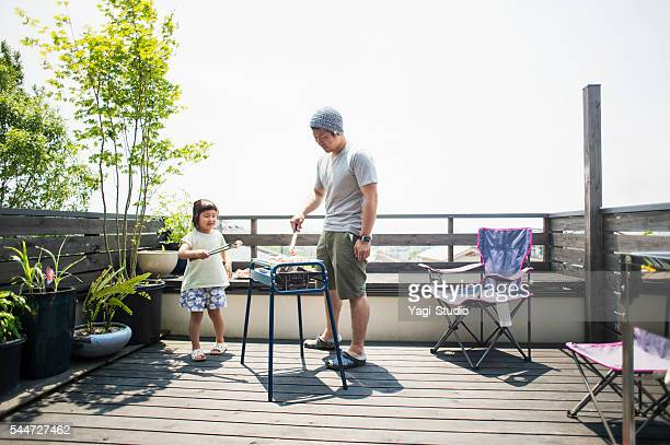Father and daughter enjoying a barbecue on the terrace