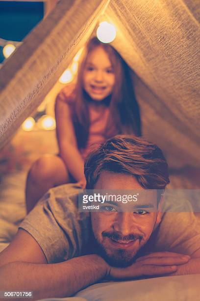 Father and daughter enjoying at home.