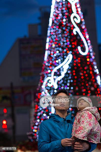 Father and daughter enjoying Christmas lights