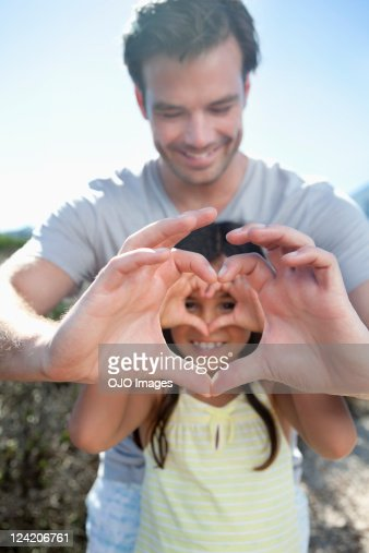 Father and daughter enjoying outdoors : Stock Photo