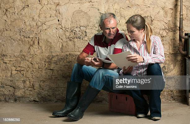 Father and daughter examining papers