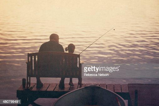 Father and daughter fishing off of pier : Stock Photo