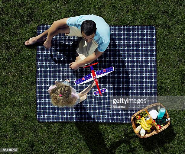 A father and daughter having a picnic