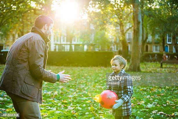 Father and daughter having fun in park