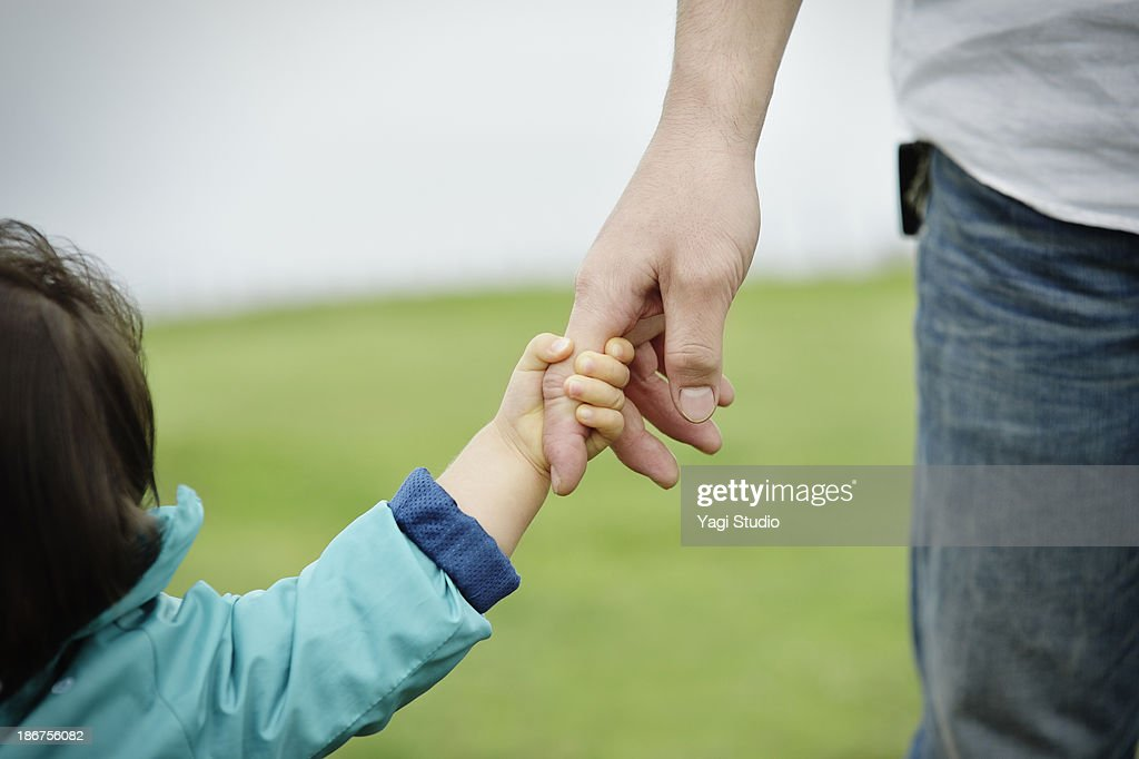 Father and daughter holding hands : Stock Photo