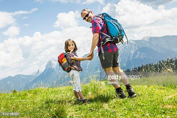 Father and daughter holding hands, Tyrol, Austria