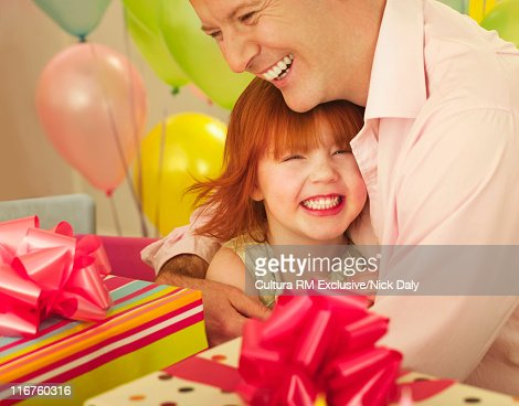 Father and daughter hugging at party : Stock Photo