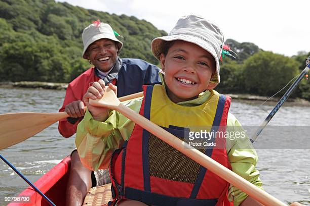 Father and daughter in boat on river