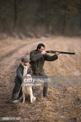 Father And Daughter In Forest Man Aiming With Shotgun ...