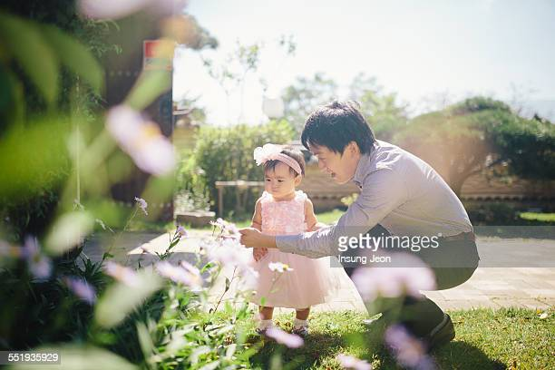 Father and daughter in garden