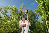 Father and daughter in orchard