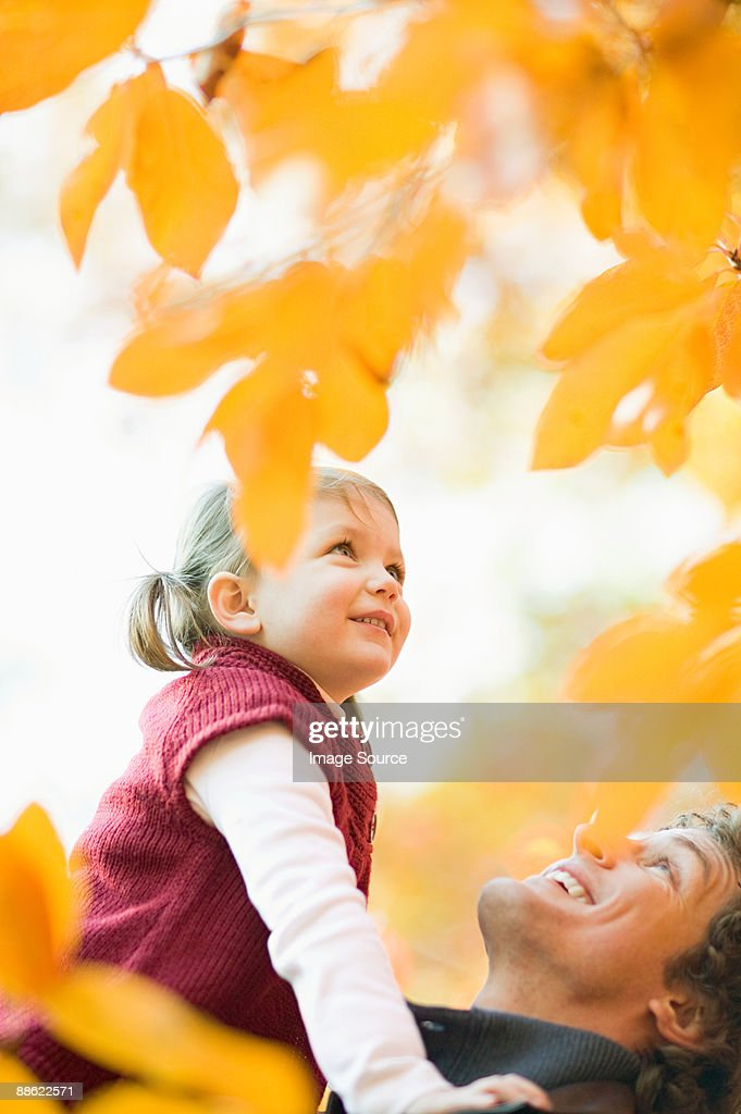 Father and daughter in park : Stock Photo