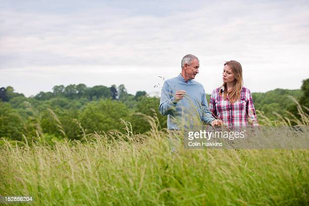 Father and daughter in tall grass