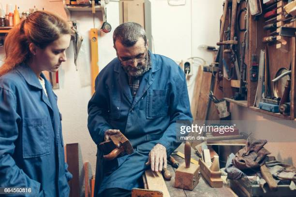 Father and daughter in the workshop