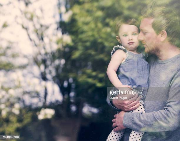 Father and Daughter in Window