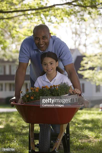 Father and daughter landscaping