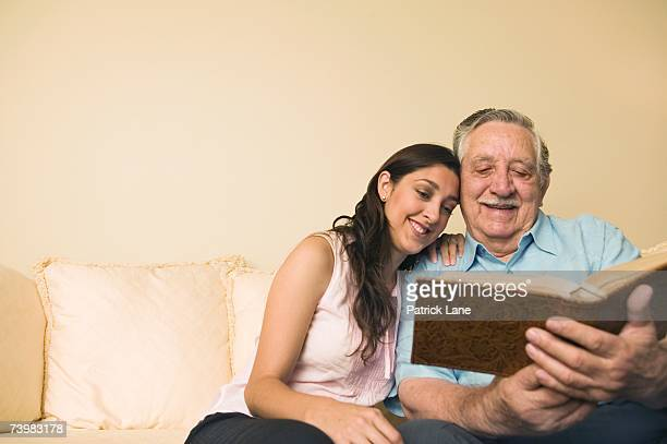 Father and daughter looking at a photo album