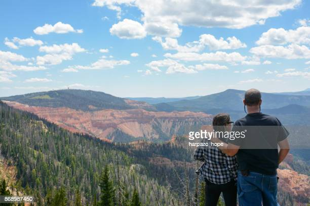Father and Daughter looking at Cedar Breaks in the distance.