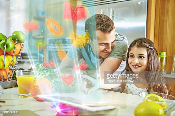 Father and daughter looking at hologram apps