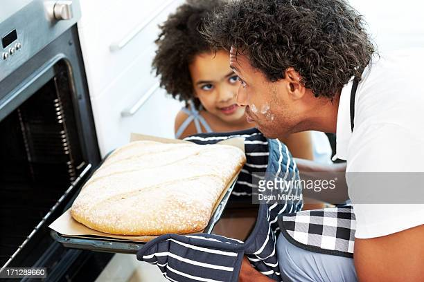 Father and daughter making bread