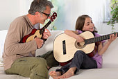 Father and daughter making music