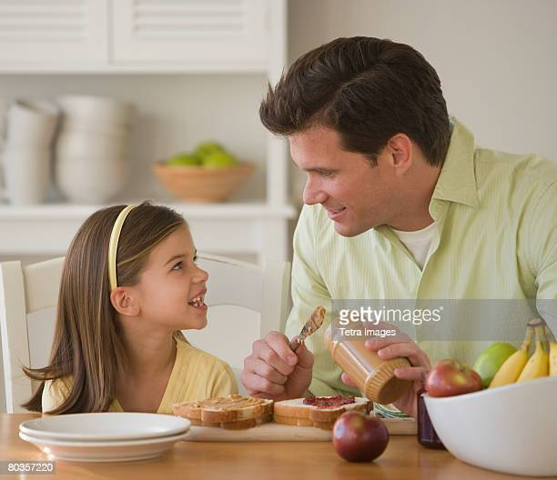 Father and daughter making sandwich
