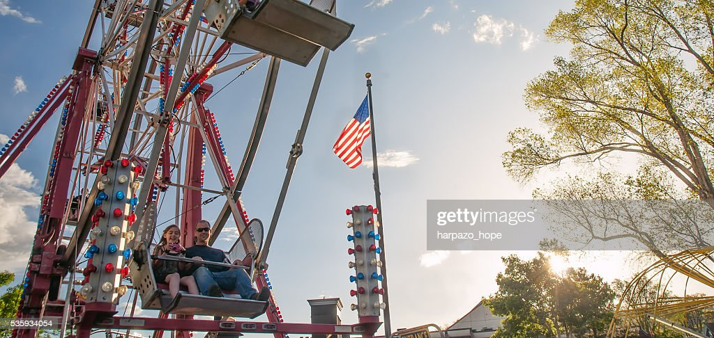 Father and daughter on a Ferris wheel. : Stock Photo