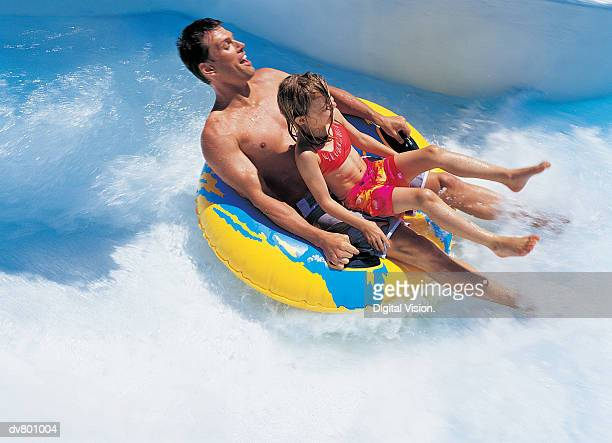 Father and Daughter on a Waterslide