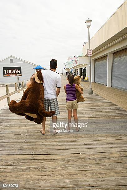 Father and daughter on boardwalk with toys