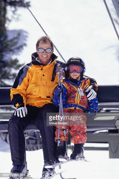 Father and daughter (6-7) on ski lift