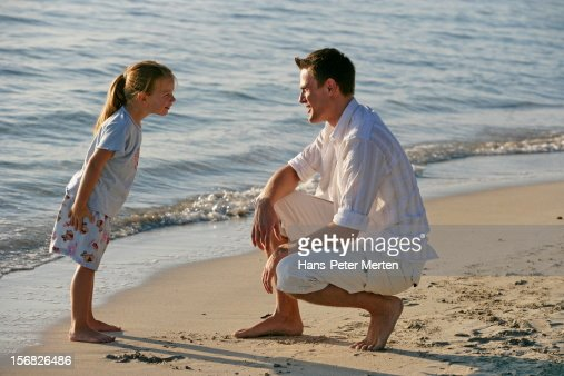 father and daughter on the beach : Stock Photo