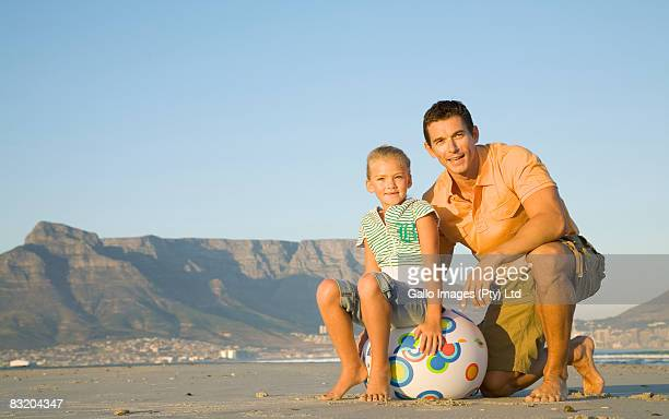 Father and daughter on the Bloubergstrand beach with Table Mountain in the background, Cape Town, Western Cape Province, South Africa