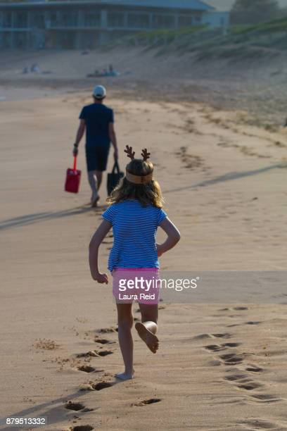 Father and daughter on the way to Carols by the Sea. An Australian Christmas Tradition.