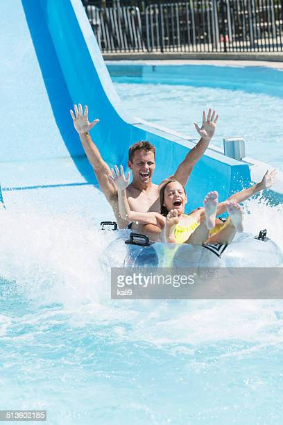 Father and daughter on water slide