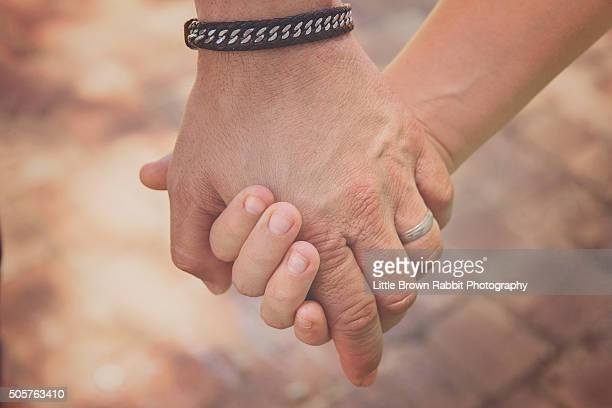 Father and Daughter or Son Holding Hands