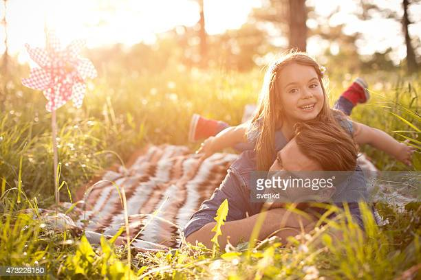 Father and daughter outdoors in a meadow.