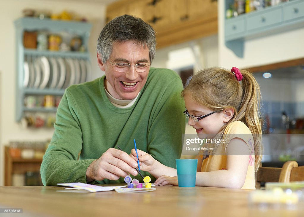 Father and daughter painting together. : Stock Photo