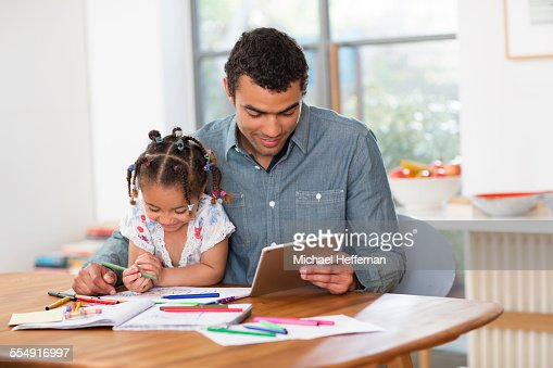 Father and daughter playing at table