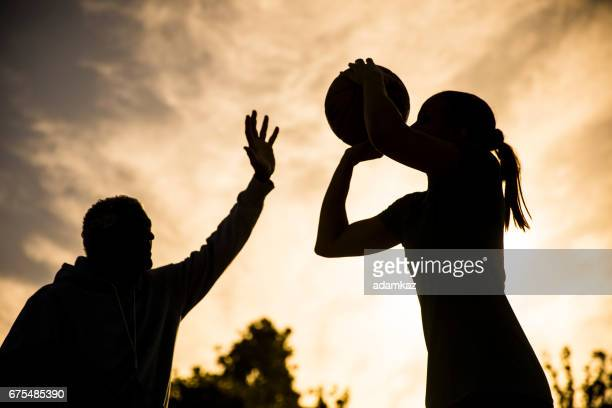 Father and Daughter Playing Basketball