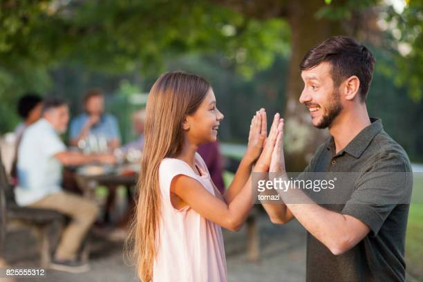 Father and daughter playing clapping game