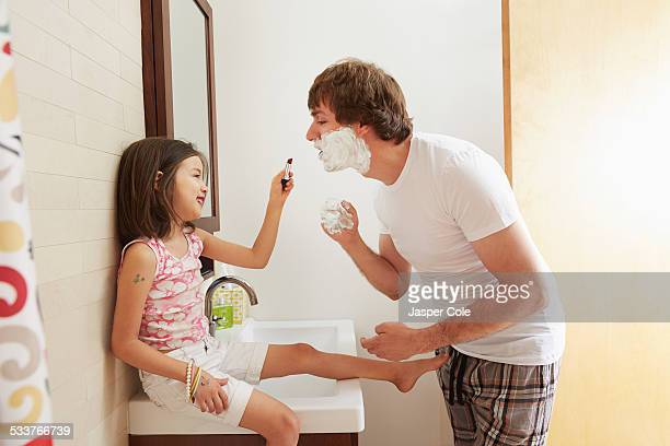 Father and daughter playing in bathroom