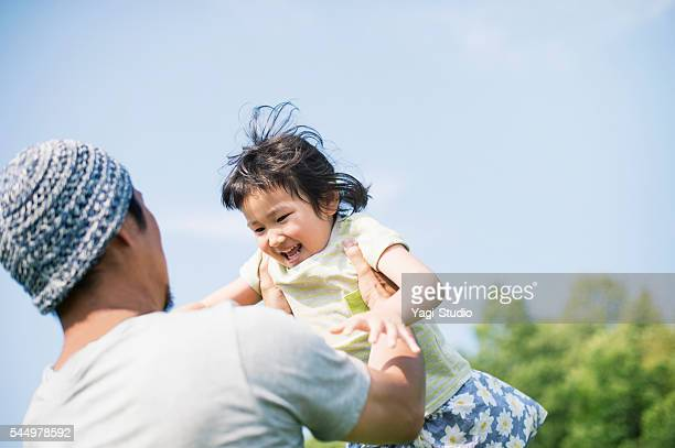 Father and daughter playing together in park