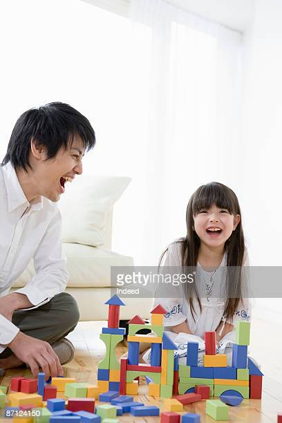 Father and daughter playing with blocks